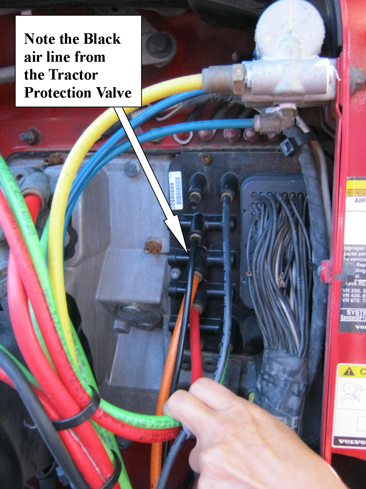 The photo was supplied by D and J (Doug) and it shows the Black air line  from the Tractor Protection Valve as described in the schematic above.